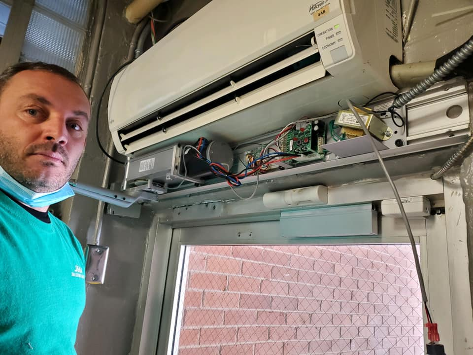 Installing an auto operator on a door for a local business