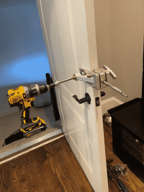 drilling a hole in a door prior to installing a new deadbolt